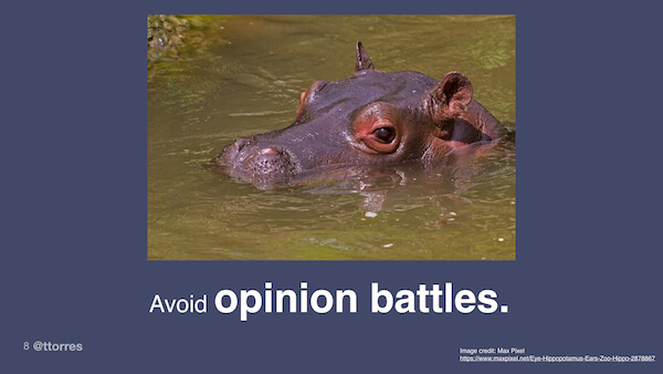 "A photograph of a hippo with the caption ""Avoid opinion battles"""